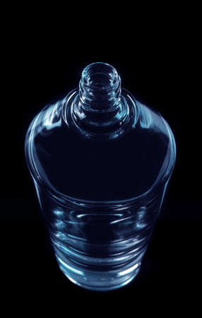 perfumery concept: Perfumery glass bottle on black background