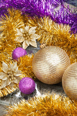 Colorful and vivid Christmas arrangement. Close Up view of Christmas golden balls with spangles and decorative tapes.