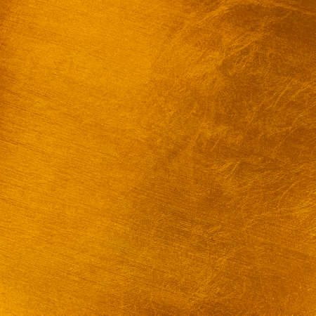 Golden color background for Christmas. Stretched marks, rough and rustic textured surface.