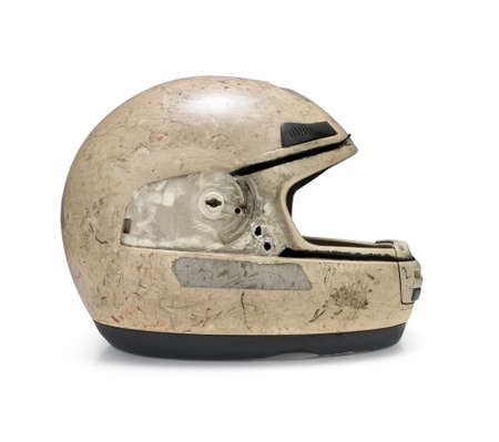 Crashed motorcycle helmet on white background. Clipping path