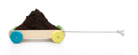 Toy car in concept traction with soil.