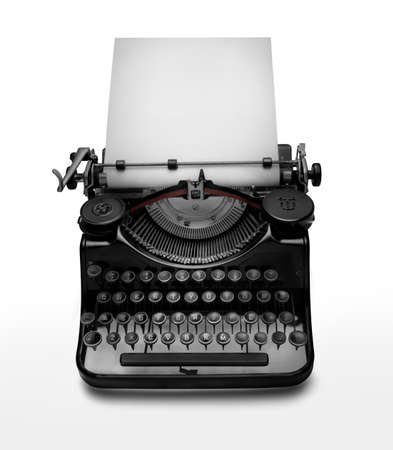 Vintage typewriter aginst white background. Low key edition of an ancient typewriter to give prominence to the space for text at the white page. Clipping path on typewriter Stock Photo