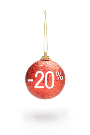 Sale off concept. Sparkling red color Christmas ball hanging from cord. 20% sale off