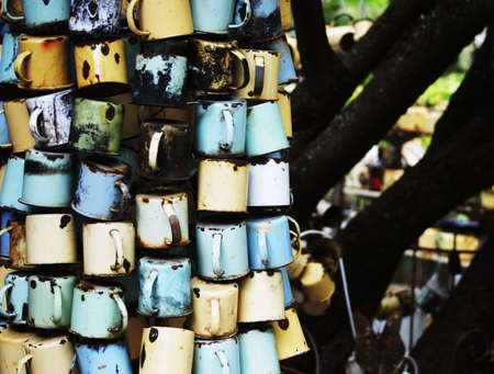 gauteng: Old tin cups hanging on wire in Cullinun Johannesburg