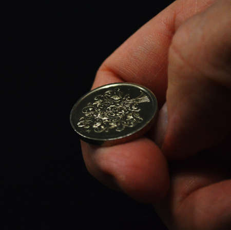Man ready to flip a coin
