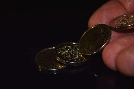 shortfall: Man dropping coins on table      Stock Photo