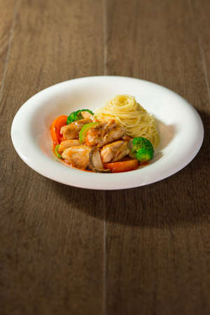 angel hair: Tomato sauce in angel hair paste with mixed vegetables, chicken