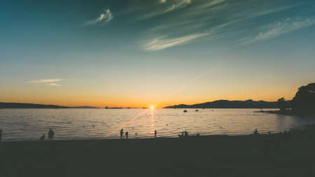 Summer sunset in British Columbia Canada. English Bay is the most popular beach for sunsets and chill in Vancouver