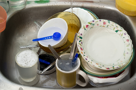 Dirty dishes in a sink  Stockfoto