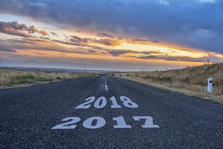 Asphalt road with a year date in it.