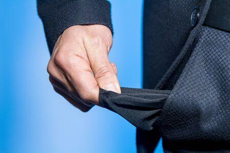Businessman pulling out his empty pocket Stok Fotoğraf