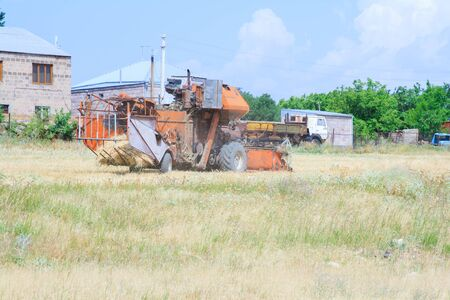 An old tractor working in a field