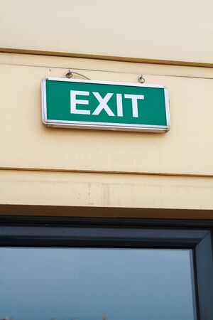 Green exit sign on the wall. 写真素材