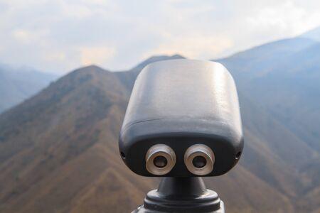 Big binoculars on the observation deck on the rocks