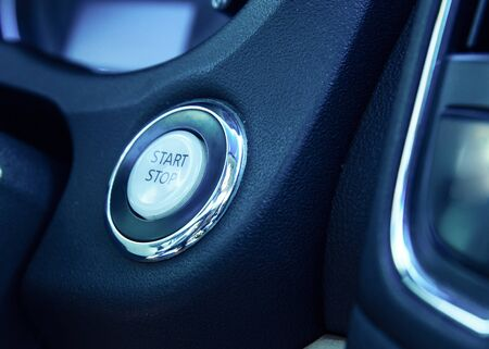 Car dashboard with focus on engine start stop button