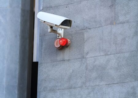 Camera attached to a wall of a building.