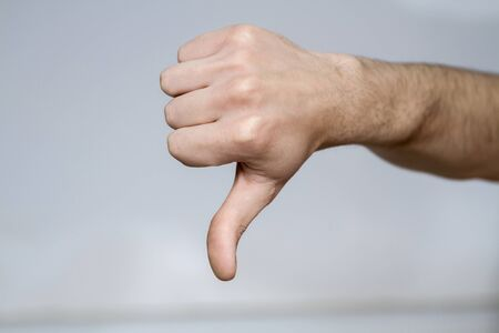 A thumbs down isolated against white background