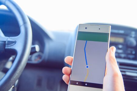 Online map and GPS application on cellphone screen.
