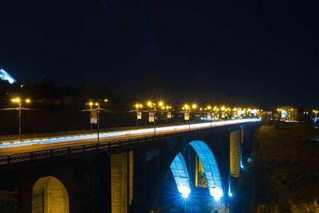 Dramatic industrial vintage river road bridge street scene at night