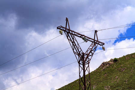 The silhouette of the electricity transmission pylon