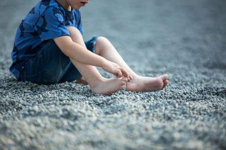Happy little boy on the beach.