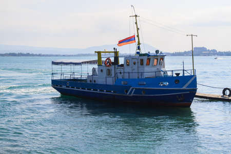 Ship in Lake Sevan with Armenian flag.  스톡 콘텐츠