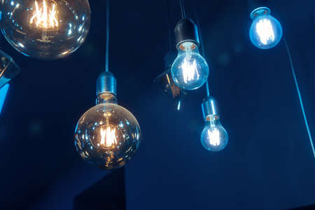 Beautiful vintage luxury light bulb hanging decor glowing in dark.