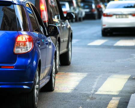 Rear light of blue color modern car on road.