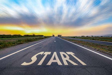 Start text on road at sunset