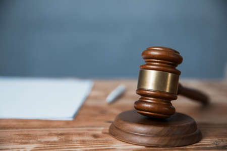 Document with judge on wooden table