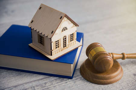 house model on book with judge on table