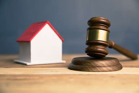 house model with judge on desk