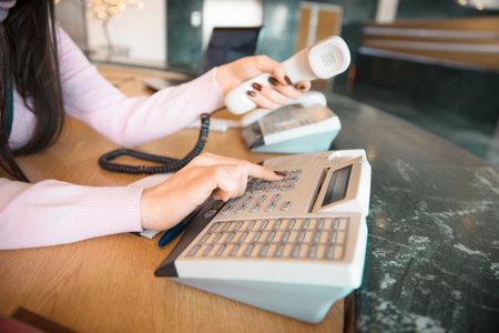 Secretary hand phones in halls background