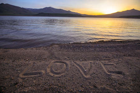 love text in beach at the sunset