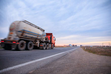 truck goes on the country highway under sky