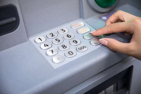 young woman in ATM / bank machine background