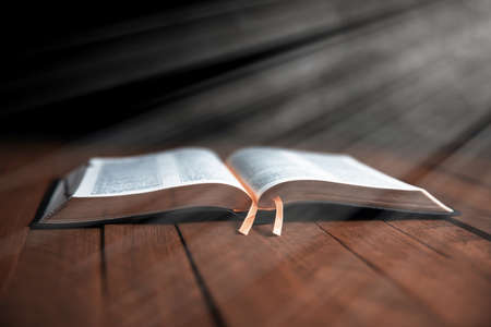Open Bible on the wooden table
