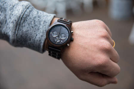 closeup luxury watch on man wrist