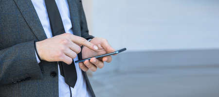 Business man hand using mobile phone
