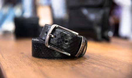belt for man on the wooden table Standard-Bild