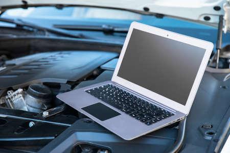 The computer diagnostics while repairing car.