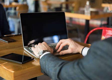 sad man working in computer in cafe Standard-Bild