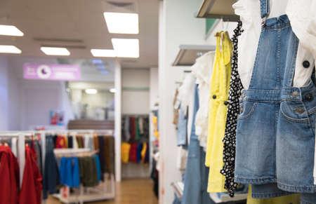 different clothes in modern shop Standard-Bild
