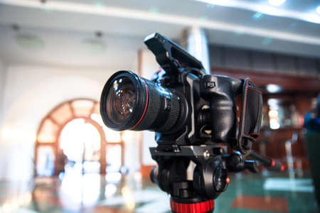 Modern professional video camera working for broadcast