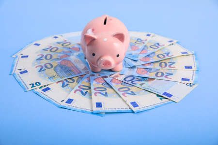piggy bank with money on the table