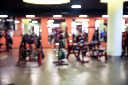Modern gym interior with equipment. Fitness club with training exercise bikes