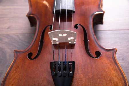 Still life violin on wood table, music instrument.