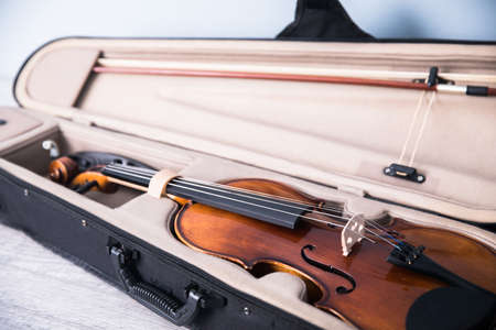 Close up of vintage violin and bows in case. Music concept