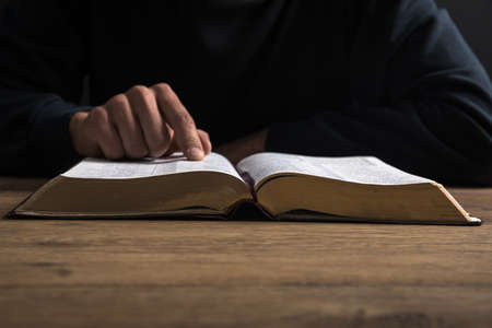 A christian man reading the Bible.