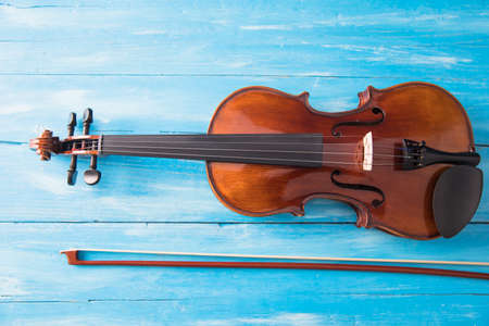 beautiful violin on the blue table background
